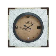 This wall clock is made from cast galvanized metal that gives it a rustic look and feel. On the corner of the border of the clock features a dark copper colored metal trim pieces that gives this piece a vintage and rustic look. The edges of the clock face are trimed in a black sculpted metal that gives this piece an additonal layer of depth. The center of this galvanized metal wall clock features burlap with printed numbers and various applied hardware around the edges of the face of the…