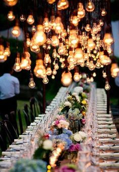 These hanging lightbulbs are simple but so pretty, they are a centerpiece in themselves.
