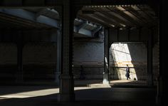 In the spotlight - Man walking in a ray of light in an old viaduct in Lyon. I blended two exposures for more detail in the shadows.