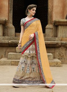 Give in to the exotic confluence of today and tomorrow in this beautiful attire. Be the sunshine of every person's eyes dressed in this stunning beige satin a line lehenga choli. Beautified with emb...