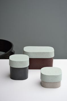 A set of containers made out of laminated cork, which we manufacture ourselves.We also colour it: the outcome isa very rich textured material. Organic and irregularshapes result fr…