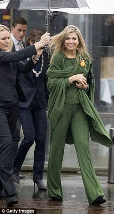 Maxima opted for a block colour of an olive green co-ord set from Dutch brand Jantaminiau complete with matching shawl for her engagement this morning