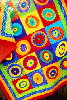 Round the Twist - fun and colorful applique and pieced quilt  pattern - Flying Fish Kits. $21.50, via Etsy.