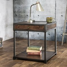 This industrial inspired end table features a beautiful appeal that stems from the gorgeous combination of wood and metal. An open shelf contrasts stunningly with the drawer tabletop.