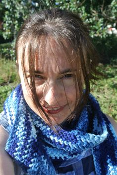 I have the perfect solution: an acrylic crochet scarf that is long enough, slim enough, and stiff enough to be able to be wrapped around the neck in lots of cool architectural ways.