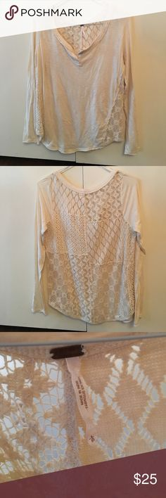Free People Long Sleeve Henley Top Size L Free People Long Sleeve Henley style (separation ok the chest but no buttons) cream top with an unique multi-style lace back. Great for fall, winter and seasonal transitions! Worn a few times but has a lot of life left in it. 100% cotton Free People Tops