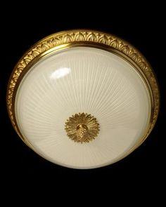 Marvin Alexander,Inc. Gilded bronze and ribbed glass flushmount with leafy gallery, four lights