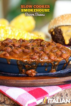 Smokehouse Bacon Beans are an easy recipes with rich and thick beans slow cooked for hours in a mixture of molasses, brown sugar, veggies and bacon, bacon and more bacon.  Most possibly the cook-out side of your dreams! #slowcooker #beans #recipe CLICK FOR RECIPE --> http://www.theslowroasteditalian.com/2014/05/slow-cooker-smokehouse-bacon-beans-recipe.html