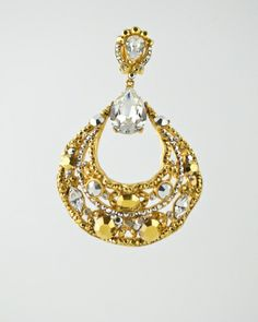 JEWELED FILAGREE GOLD & CRY EAR: 24 karat gold plated filagree drop hoop adorned with Austrian crystals in clear crystal and gold plate. Earring is clip on and measures 3 inches long and 2 inches at widest point. Get a 20% discount with promo code: Olusegun683. $440