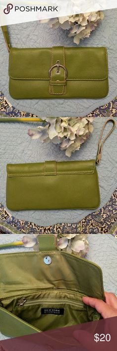 New York and company green wristlet New York and company green leather wristlet. Size is 10 x5 inches. Magnetic snap closure and a small zippered section inside. From smoke free home. New York & Company Bags Clutches & Wristlets