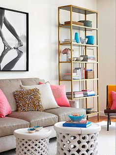 Etagere, white garden stools, bright pillows lighten a space