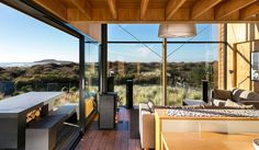 Houzz Tour: Simple Vacation Style in New Zealand -Humble materials and a familiar form help make this fishing-village retreat restful, comfortable and even uplifting