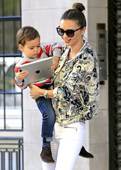 Miranda Kerr's adorable little boy, Flynn, played with an iPad as his supermodel mom carried him out of their apartment.