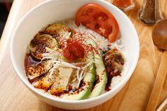 Spicy vegetarian ramen with soy milk, avocado, zucchini, tofu, mushrooms, tomato, and scallion - Mr. Taka Ramen, 170 Allen St., NY, NY. 212-254-1508