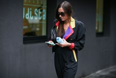 How To Dress Like An Italian Girl — 50+ Lessons Worth Knowing #refinery29  http://www.refinery29.com/2014/09/74945/milan-fashion-week-2014-street-style#slide-51  A jumpsuit to fuel your thrifting daydreams....