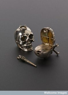 Skull vinaigrette (18th century). This could be used as a vessel to hold strong smelling substances to be sniffed...
