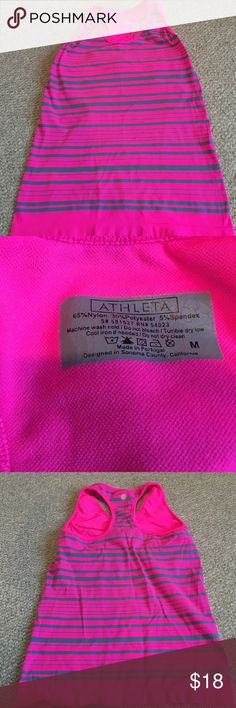 Athleta tank Athleta tank with built in bra for low impact activities. EUC. 65% Nylon, 30% Polyester. 5% Spandex. Comfy and stylish. Easy to throw in and go. Reasonable offers accepted. Athleta Tops Tank Tops