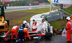 Jules Bianchi of France and Marussia receives urgent medical treatment after crashing during the Japanese Formula One Grand Prix at Suzuka Circuit on October 5, 2014 in Suzuka, Japan. #Japan2014