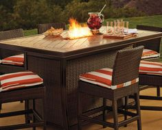 Drink, dine, and converse around the warm glow of firelight with this attractive, counter-height fire table.
