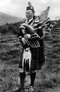 Old photograph of a Royal Piper in Highland Perthshire, Scotland