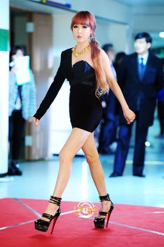 2ne1's Park Bom 2012  Ombre hair, crazy high heels, one-shoulder dress, gold jewelry... <3 it all