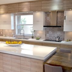 This large contemporary kitchen features natural wood tones that gives the room a warm and inviting feeling. The white cabinets and countertop adds an attractive lighting feature. By Kabco Kitchen, Florida Kitchen Cabinet Colors, Kitchen Cabinetry, Wood Cabinets, Kitchen Colors, White Cabinets, Kitchen Ideas, Contemporary L Shaped Kitchens, Contemporary Kitchen Design, Contemporary Style