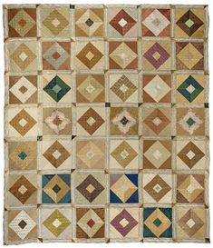 """Quaker Quilts: Square-in-Square Quilt made ca. 1835-1850 in Philadelphia, Pennsylvania.  Photograph produced courtesy of the American Museum in Britain.  This lovely quilt measures 96"""" X 84"""" and is comprised of 42 Square-in-Square blocks pieced using shades of brown, fawn, gold, and blue and connected by a delicate, striped silk sashing.  The blocks are quilted with cross-hatching and straight parallel lines while the sashing is quilted with a simple leaf design."""