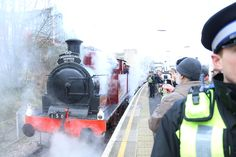 Steam train departs Kensington (Olympia) Tube station