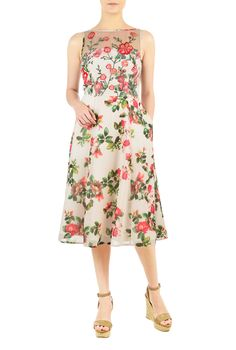 Floral embellished tulle patterns the bodice of our flowy A-line floral print georgette dress featuring a boat neckline and a figure-flattering seamed waist.