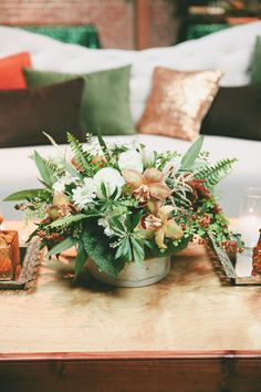 Greenery with Bronze Orchids - Gorgeous Centerpiece for a fall wedding !! More on SMP: http://www.StyleMePretty.com/2014/02/28/botanical-inspired-wedding-at-marvimon/ onelove photography onelove photography
