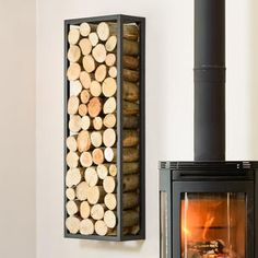 Buy Rectangle Steel Log Holder — The Worm that Turned - revitalising your outdoor space Wood Stove Wall, Wood Burner Fireplace, Firewood Holder, Firewood Storage, Corner Log Burner, Alcove Shelving, Log Wall, Log Holder, Wood Store