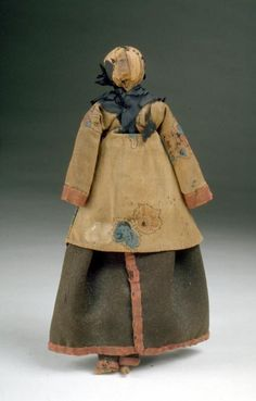 Cornhusk dolls were popular toys made and used by Native Americans. This doll may have been created to sell to tourists traveling to Maine or eastern Canada in the early 19th century. It is made of cornhusks and has a dark brown wool skirt and leggings trimmed with red fabric, a calico print tunic and a black silk kerchief. The leggings are part of traditional Native clothing.