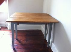 Vintage-drop-leaf-wooden-table