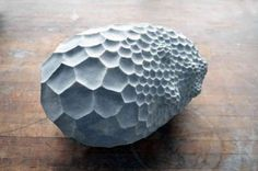 Porous Boulder-Like Sculptures Chiseled from...   Colossal