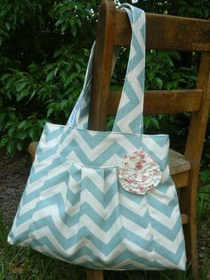 Blue Chevron On The GO Diaper Bag with pink polka dot rosette. $47.00, via Etsy. @Tiffani Cluff this should be your next custom item :)
