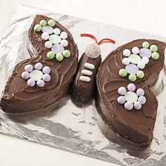 Butterfly Cake - Idea for Stella's birthday cake, but we'd use orange and pink frosting