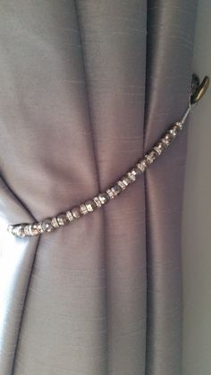 Beaded drapery tie-back with slate grey & crystal beads on