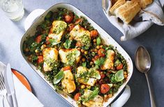 Baked halloumi with chickpeas and greens recipe (<< this but with red pepper, red onion & chopped tomatoes instead of cherry tomatoes) Chickpea Recipes, Veggie Recipes, Cooking Recipes, Healthy Recipes, Healthy Food, Healthy Dinners, Veggie Meals, Simple Recipes, Veggie Food
