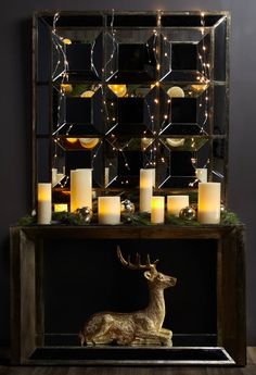 No mantel? No problem! Adorn a console table with garland, candles and holiday accessories.