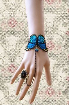 Gorgeous Blue Butterfly Bracelet Feather & Wings of any Kind Keka❤❤❤ Hand Jewelry, Cute Jewelry, Beaded Jewelry, Jewelry Accessories, Fashion Accessories, Handmade Jewelry, Jewelry Design, Fashion Jewelry, Jewellery
