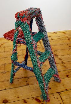 I so need to do this for my display ladder! guerilla crochet by Olek