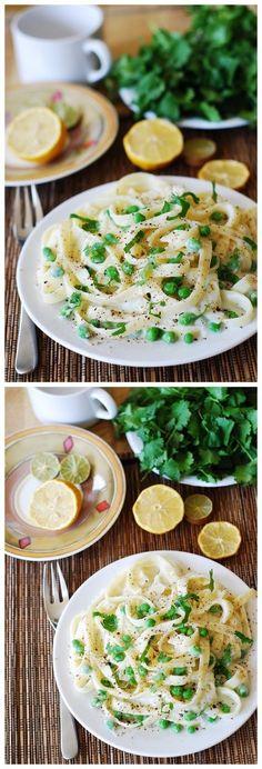 Healthy fettuccine alfredo with cauliflower sauce and sweet peas