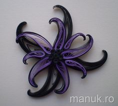 Quilling is cool. Here's a brief tutorial on shaping this beautiful flower.