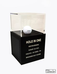 Modern HOLE IN ONE Display Golf Ball Display Cases CNC Machined Anodized Aluminum Black with black carbon Fiber Design. Golf Trophy Cases, Hole In One Plaques. Modern Golf Displays and Trophies. Made in the USA. Order on our website shipping worldwide. ALUDESIGNUS Golf Display luxury golf accessories #Ace #HoleinOne #Holein1