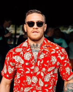 87bd6f3729c4 Spott - Conor McGregor wearing a red floral-printed Gucci silk shirt