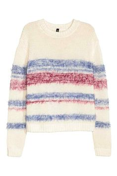 Knitted jumper: Jumper in a soft, loose knit with dropped shoulders and long sleeves.