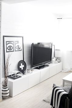 BLACK & WHITE! Large art beside the tv, low cabinet. (www.noepahjertet.com. Ikea besta units in white)