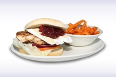 Chicken & Brie Burger - 100% Chicken Breast topped with Sliced Brie Cheese and Cranberry Sauce. Served with Chips.