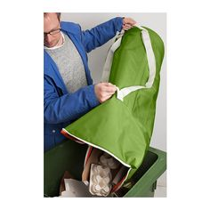 HUMLARE Bag IKEA This bag can be carried by the handle or like a backpack. Easy to lift and empty as there are handles on both the top and b...