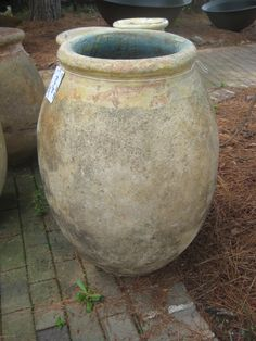 Love this urn!  http://www.antiques.com/vendor_item_images/ori_2093_882945397_1111150_2100004_French_antique_olive_jar.jpg